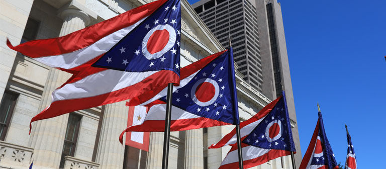 Ohio state flags in front of the statehouse